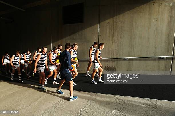 Geelong Cats players come onto the field lead by their captain Joel Selwood before the round six AFL match between Port Adelaide Power and the...