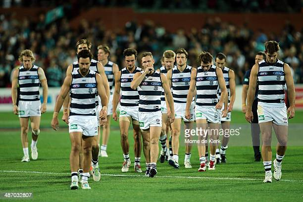 Geelong Cats players make their way from the field after the round six AFL match between Port Adelaide Power and the Geelong Cats at Adelaide Oval on...