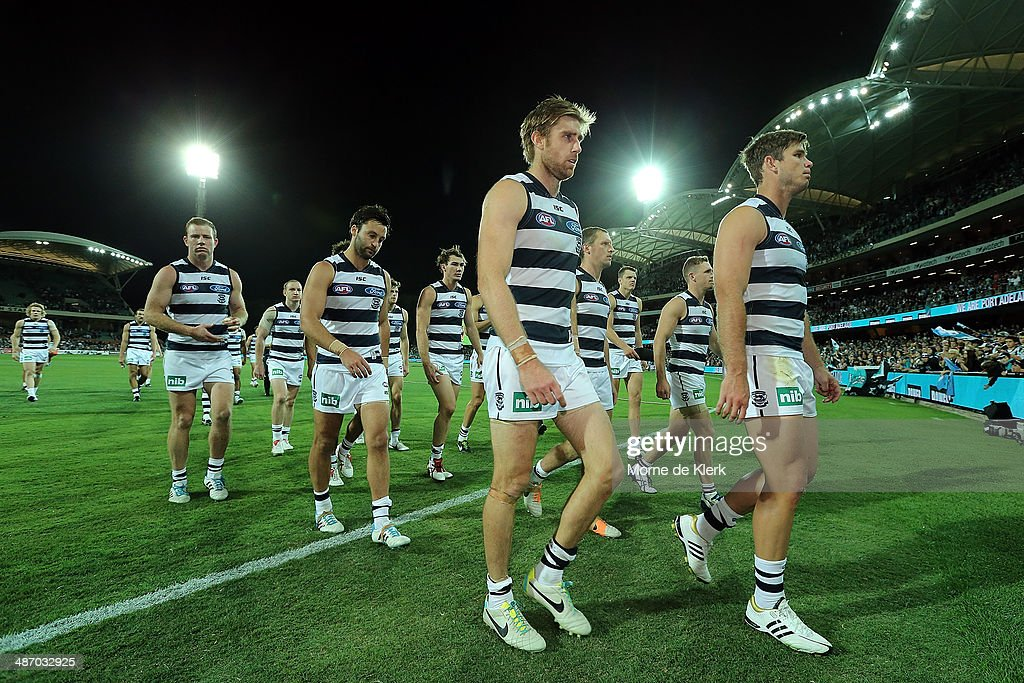 Geelong Cats players make their way from the field after the round six AFL match between Port Adelaide Power and the Geelong Cats at Adelaide Oval on April 27, 2014 in Adelaide, Australia.
