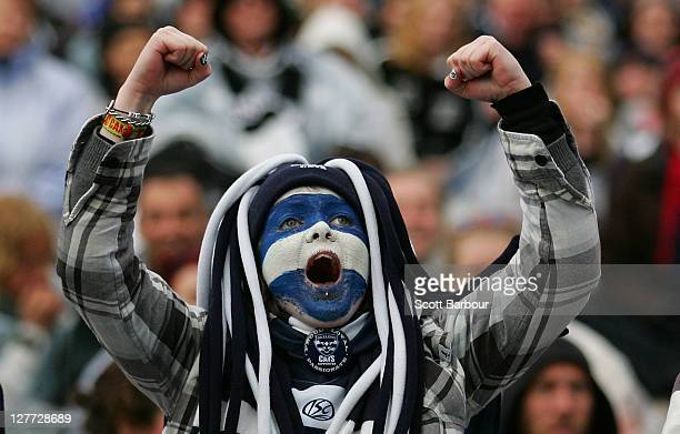 Geelong Cats supporter celebrates as he watches the 2011 AFL Grand Final match between the Collingwood Magpies and the Geelong Cats at Federation...