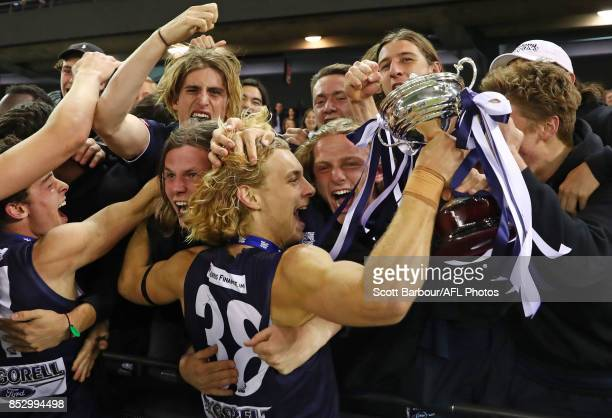 Geelong Falcons captain James Worpel celebrates with the trophy and fans in the crowd after winning the TAC Cup Grand Final match between Geelong and...