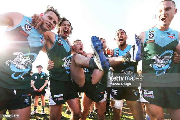 Geelong players celebrate victory during the Bellarine Football League Grand Final match between Geelong Amateurs and Ocean Grove on September 13...