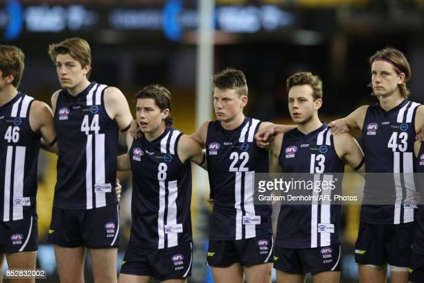 Geelong players line up during the national anthem prior to the TAC Cup Grand Final match between Geelong and Sandringham at Etihad Stadium on...