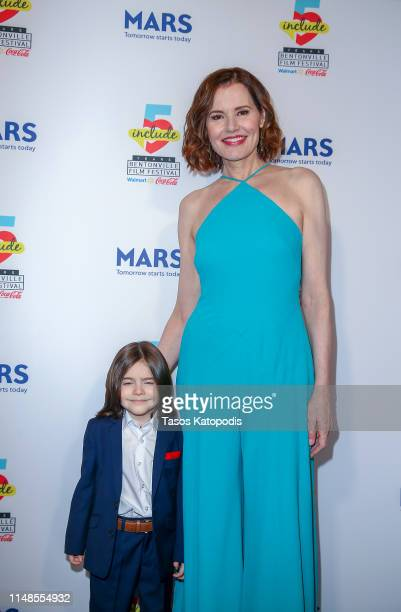 Geena Davis and Elijah Maximus of Carol of The Bells walk the blue carpet for the filmmaker awards ceremony at the 5th Annual Bentonville Film...