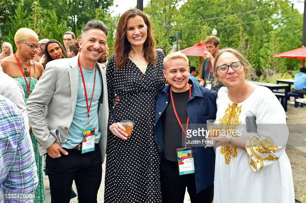 Geena Davis poses with guests at the 2021 Bentonville Film Festival opening night red carpet and filmmaker reception on August 04, 2021 in...