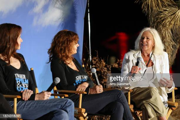 """Geena Davis, Susan Sarandon, and Callie Khouri speak onstage during """"Thelma And Louise"""" 30th Anniversary drive-in charity screening experience hosted..."""