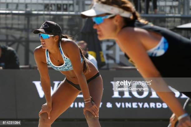 Geena Urango and Angela Bensend look on in a semifinal against Lane Carico and Alix Klineman during day 4 of the AVP San Francisco Open at Pier 3032...