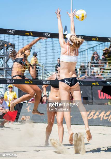 Geena Urango sends a hit over the net past Emily Day in the women's Finals of the AVP Pro Beach Volleyball Tour on Sunday July 8 2018 at Pier 32 in...
