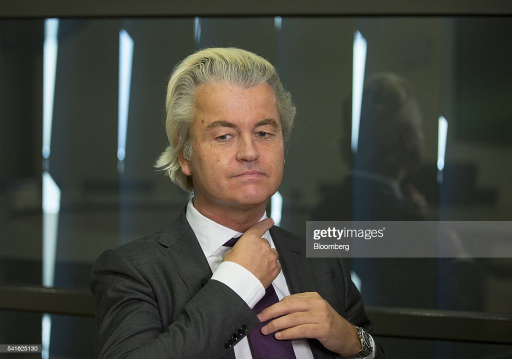 Geert Wilders, leader of the Freedom Party, adjusts his neck tie during an interview in The Hague, Netherlands, on Thursday, June 16, 2016. Dutch Prime Minister Mark Rutte said that he wouldnt rule out governing with anti-Islam Freedom Party leader Wilders, as he acknowledged a collective failure by traditional parties to adequately respond to voter concerns. Photographer: Jasper Juinen/Bloomberg via Getty Images