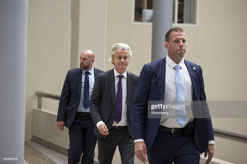 Geert Wilders, leader of the Freedom Party, center, arrives for a session in parliament in The Hague, Netherlands, on Thursday, June 16, 2016. Dutch Prime Minister Mark Rutte said that he wouldnt rule out governing with anti-Islam Freedom Party leader Wilders, as he acknowledged a collective failure by traditional parties to adequately respond to voter concerns. Photographer: Jasper Juinen/Bloomberg via Getty Images