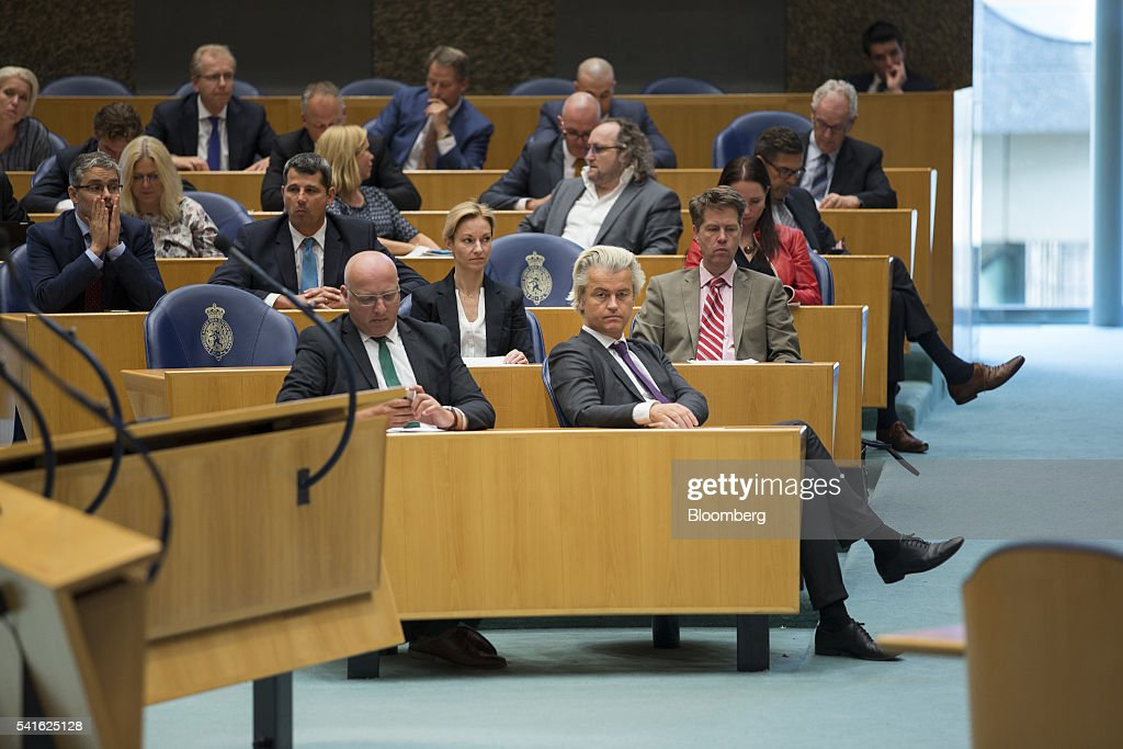 Geert Wilders, leader of the Freedom Party, center, looks on during a session in parliament in The Hague, Netherlands, on Thursday, June 16, 2016. Dutch Prime Minister Mark Rutte said that he wouldnt rule out governing with anti-Islam Freedom Party leader Wilders, as he acknowledged a collective failure by traditional parties to adequately respond to voter concerns. Photographer: Jasper Juinen/Bloomberg via Getty Images