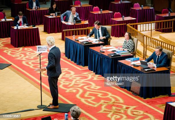 Geert Wilders , speaks as outgoing Prime Minister Mark Rutte , outgoing Minister of Medical Care Tamara van Ark and outgoing Minister of Health,...