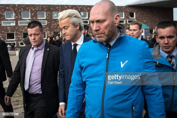 Geert Wilders the leader of the rightwing Party for Freedom leaves after casting his vote during the Dutch general election on March 15 2017 in The...