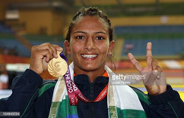 Geeta of India celebrates with her Gold medal after the 55kg final in the womens wrestling at the IG Sports Complex during day four of the Delhi 2010...