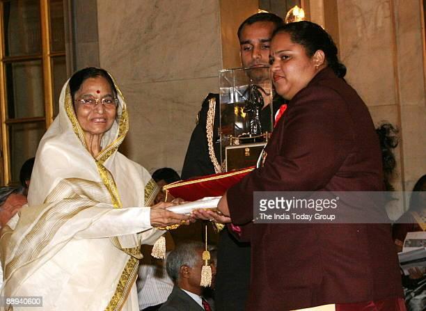 Geeta Rani Weightlifter Receiving the Arjuna award from Pratibha Devisingh Patil President of India in New Delhi India