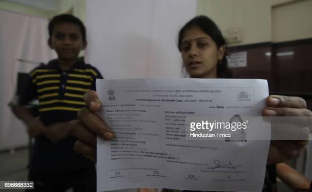 Geeta shows her acknowledgement copy after getting Iris scanned at UID enrollment at Kawalmathe BMC school in Mumbai