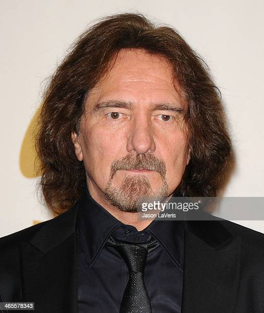 Geezer Butler of Black Sabbath poses in the press room at the 56th GRAMMY Awards at Staples Center on January 26 2014 in Los Angeles California