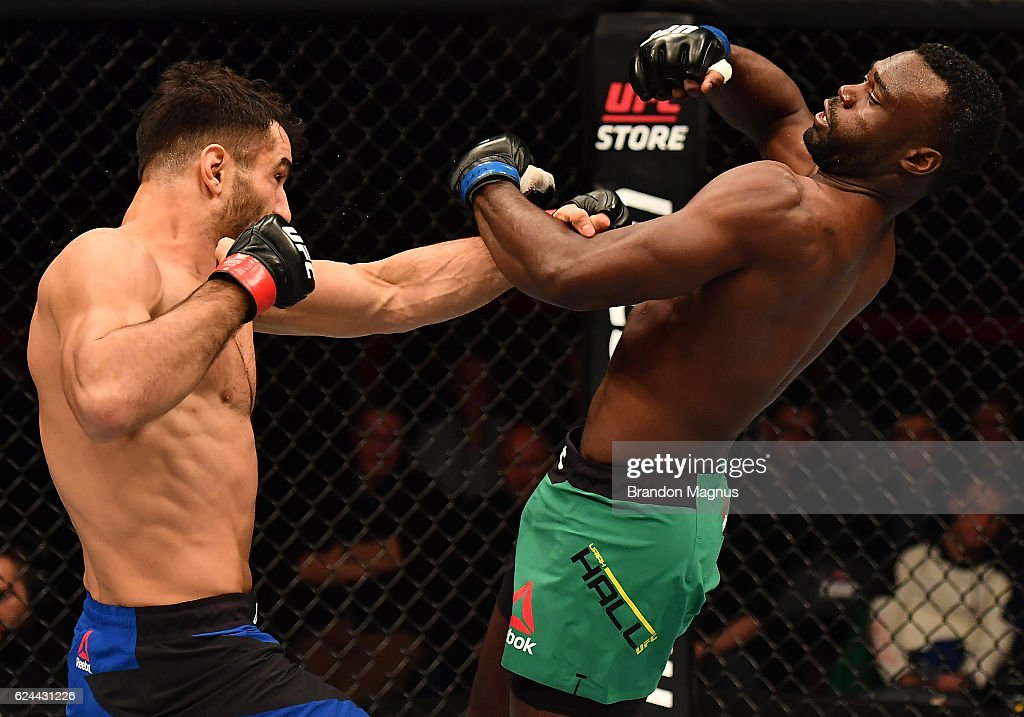 Gegard Mousasi of Iran punches Uriah Hall of Jamaica in their middleweight bout during the UFC Fight Night at the SSE Arena on November 19, 2016 in Belfast, Northern Ireland.