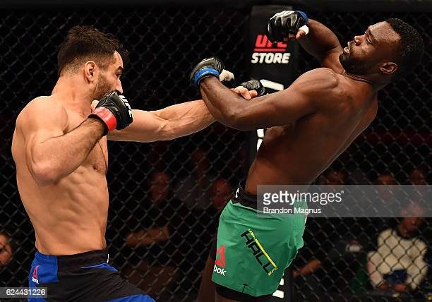 Gegard Mousasi of Iran punches Uriah Hall of Jamaica in their middleweight bout during the UFC Fight Night at the SSE Arena on November 19 2016 in...