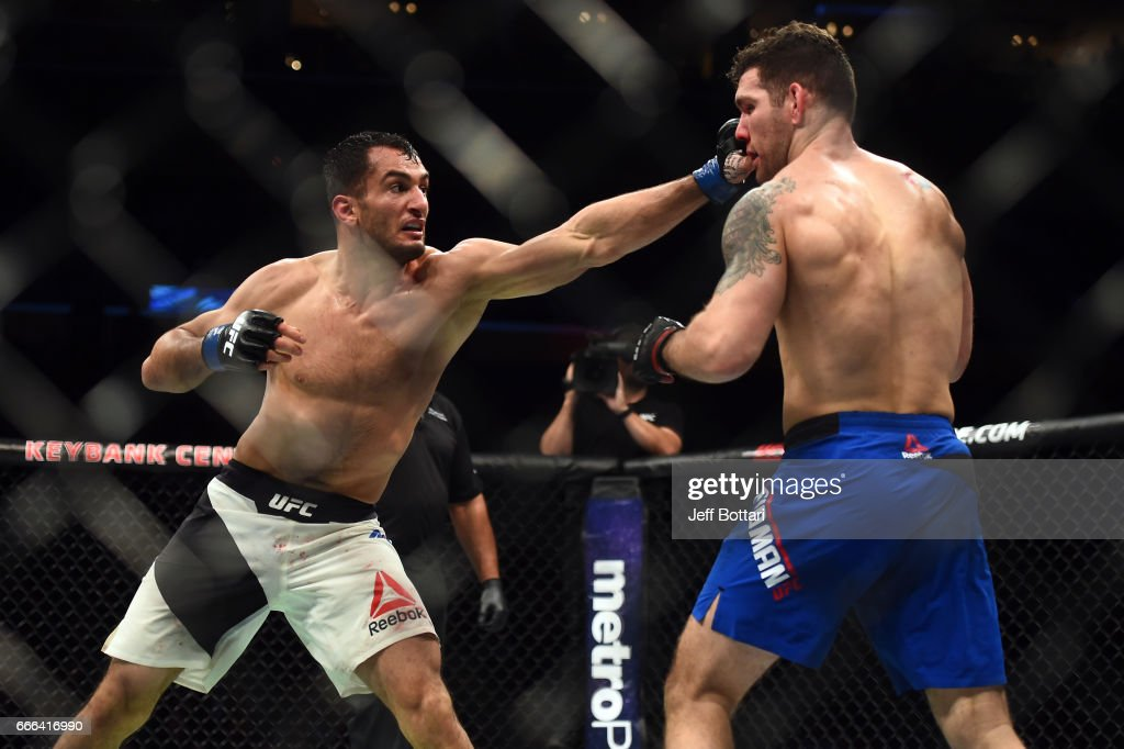 Gegard Mousasi of the Netherlands punches Chris Weidman in their middleweight bout during the UFC 210 event at the KeyBank Center on April 8, 2017 in Buffalo, New York.