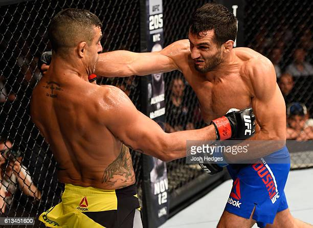Gegard Mousasi of The Netherlands punches Vitor Belfort of Brazil in their middleweight bout during the UFC 204 Fight Night at the Manchester Evening...
