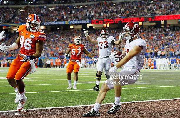 Gehrig Dieter of the Alabama Crimson Tide completes a pass for a second quarter touchdown against the Florida Gators during the SEC Championship game...