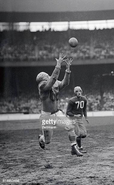 Gehrke of the Cleveland Rams runs 15 yards for a touchdown. He pulls cuff of the Giants across the line with him in the 3rd period of their game at...