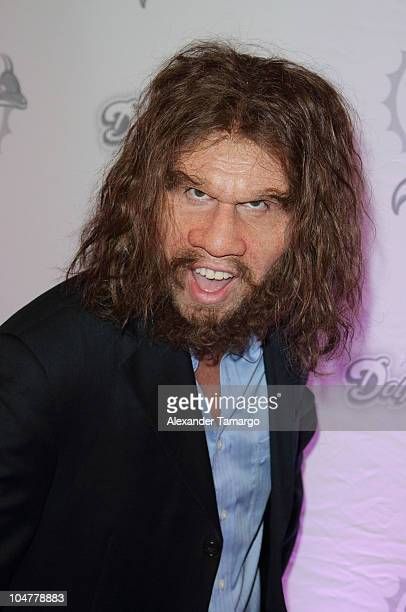 Geico Caveman arrives at the Miami Dolphins versus the New England Patriots game at Sun Life Stadium on October 4 2010 in Miami Florida