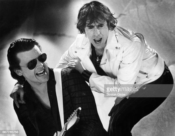 J Geils left and Peter Wolf of The J Geils Band film a performance of 'Freeze Frame' for a music video at Central Studios in Boston on Feb 8 1982