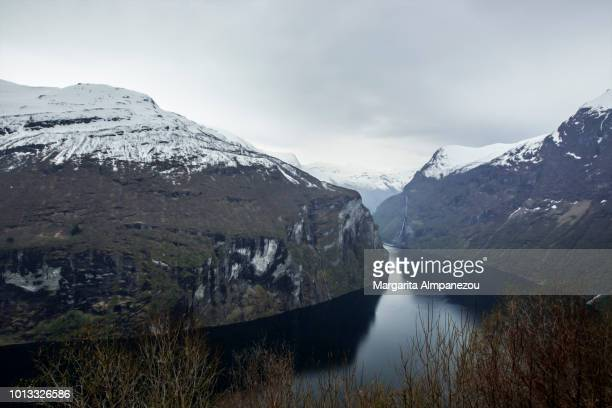 Geiranger Fjord with snowy mountains from above