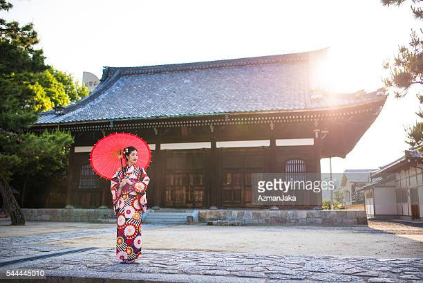 geisha at the temple - kyoto prefecture stock pictures, royalty-free photos & images