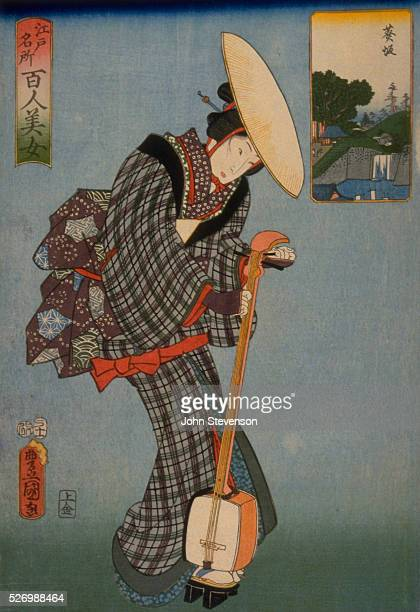 A geisha carries her shamisen to a restaurant by a manmade waterfall shown in the cartouche behind her Here she will play and entertain She wears a...