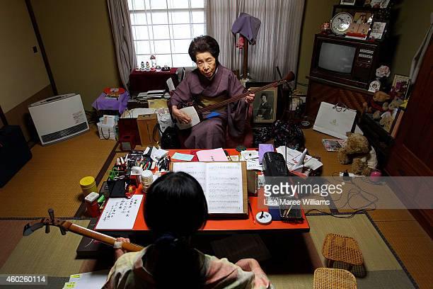 Geisha Chino attends singing and shamisen classes with Geisha Yuko Asakusa at her home studio in the Asakusa District on November 6 2014 in Tokyo...
