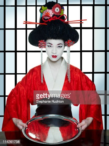 Geisha Girl Holding An Empty Tray Stock Photo Getty Images