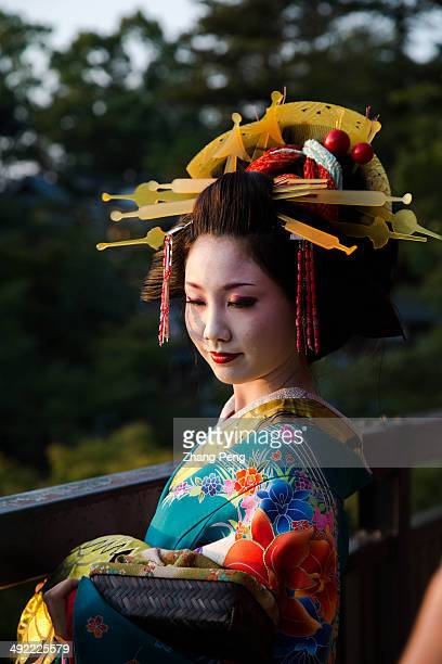 Geisha girl makes a posture for tourists taking pictures in Kiyomizu Temple Geisha is a famous traditional folk art performance in Japan It is still...