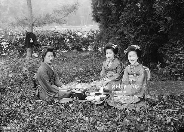 Geisha girls photographed out of doors Japan Undated