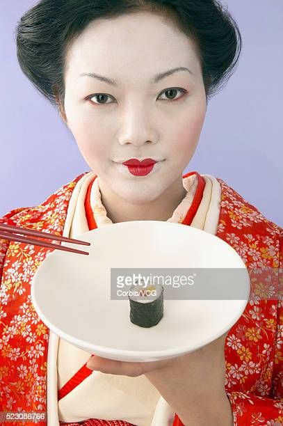 Geisha Holding Sushi and Chopsticks