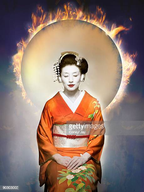 Geisha listening to music with fire in the backgr