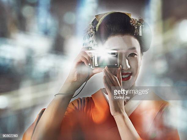 geisha taking a photo with her digital camera outd - coneyl stock pictures, royalty-free photos & images