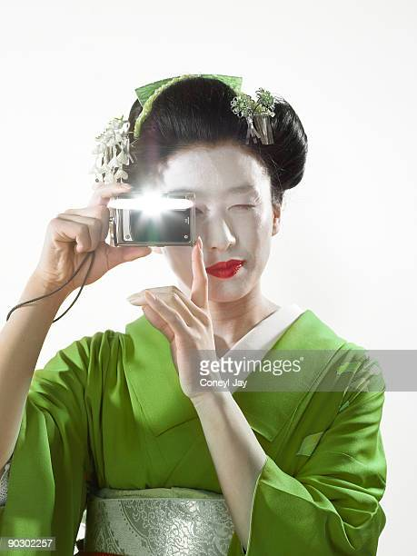 geisha taking a photo with her digital camera - coneyl stock pictures, royalty-free photos & images
