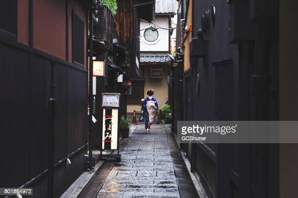Geisha walking through narrow alleys of Gion in Kyoto