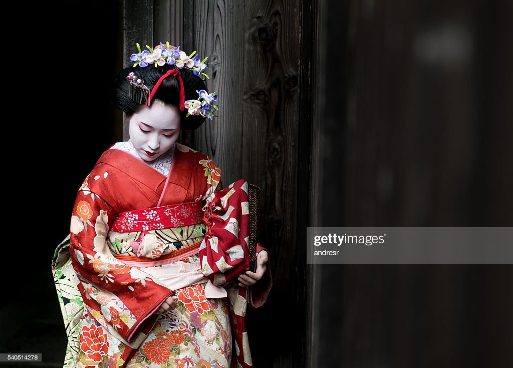 Geisha wearing a beautiful kimono : Stock-Foto