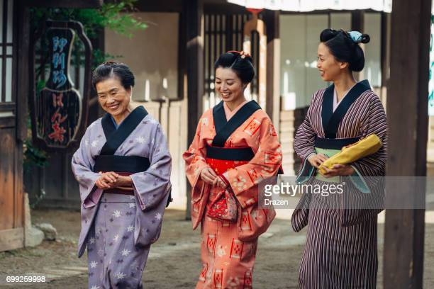 geishas in japanese historic village - traditional clothing stock photos and pictures