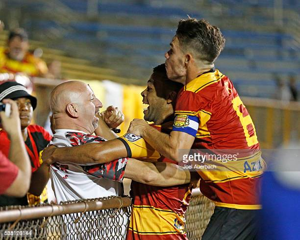Geison Moura celebrates his first half goal with a fan and PC of the Fort Lauderdale Strikers against the New York Cosmos on June 4 2016 at Lockhart...