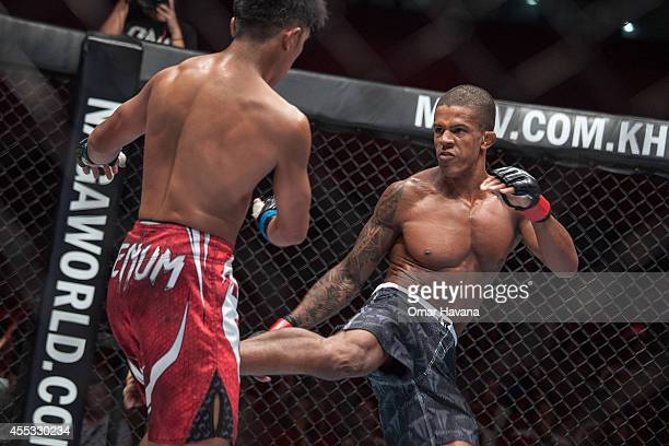 Geje Eustaquio competes against Adriano Moraes for the Flyweight World Championship during One FC Cambodia on September 12 2014 in Phnom Penh Cambodia