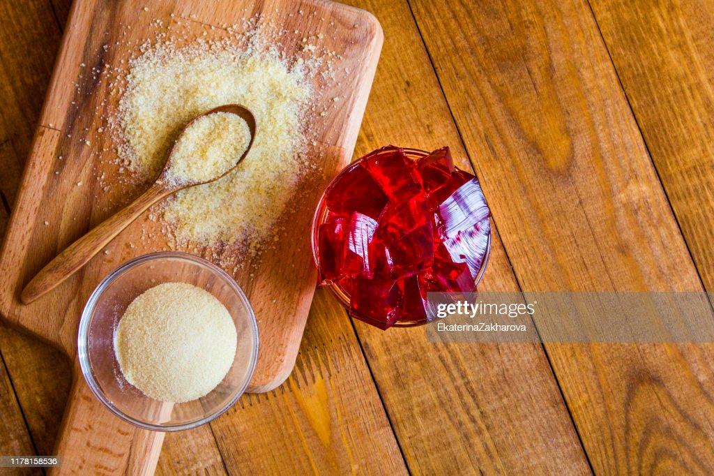 Gelatin powder on wooden background : Stock Photo