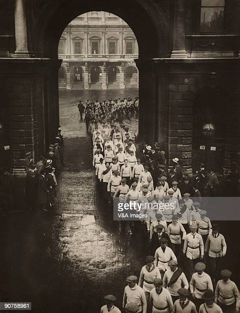 'UNITED KINGDOM NOVEMBER 15 Gelatin silver print Photograph by Horace W Nicholls of a procession of men filing out of the the Royal Academy of Arts...