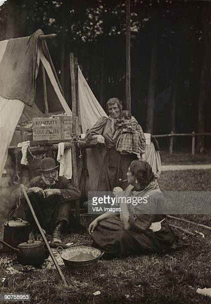 'UNITED KINGDOM NOVEMBER 15 Gelatin silver print Photograph by Horace W Nicholls of a traveller family smoking by a camp fire They are possibly at...