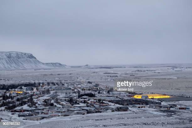 Geld leuchten die mit Erdwärme betrieben Gewächshäuser in der Stadt Hveragerði in Island