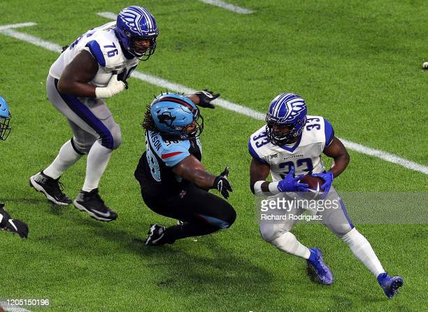 Gelen Robinson of the Dallas Renegades tries to stop the run by Christine Michael of the St Louis Battlehawks in the third quarter at an XFL Game on...
